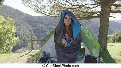 Funny female in sleeping bag - Young laughing female having...