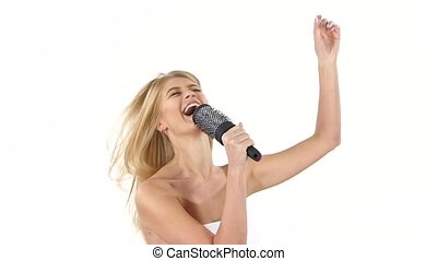 Funny female sing song in comb. slow motion, bathroom