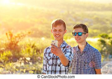 funny friends take selfies on a Sunny day