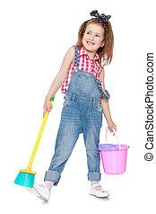Funny funny little girl in denim overalls holding