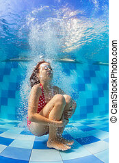 Funny girl dive in swimming pool