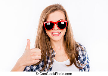 Funny girl in glasses with a red rim showing thumbs up