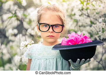 Funny girl in glasses with hat and gloves.