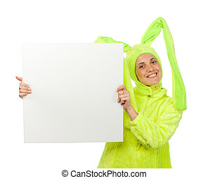 Funny girl in rabbit costume with blank board