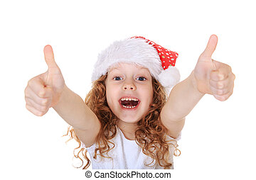 Funny girl in Santa hat showing thumbs up, on light snow background.