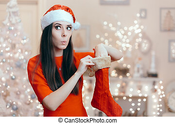 Funny Girl Looking for Her Gift in a Christmas Stocking