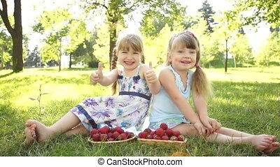 Funny girl near the basket strawber