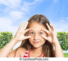 funny girl on blue sky background