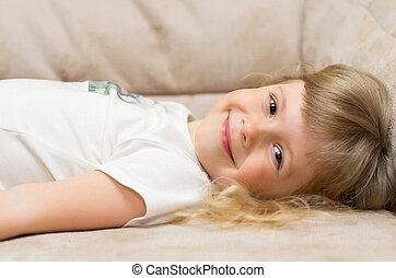 Funny girl on sofa
