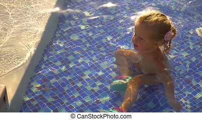 Funny girl playing in swimming pool. Set from 3 videos -...