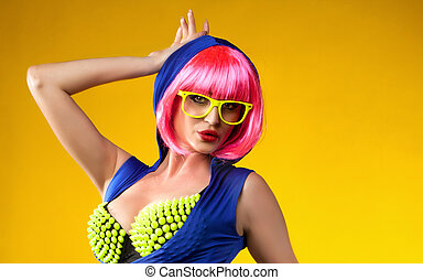 Funny girl posing in pink wig.