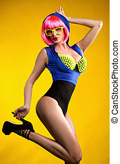 Funny girl posing in pink wig.
