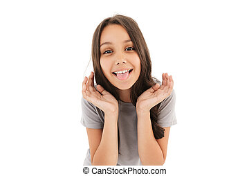 Funny girl standing isolated over white wall background.