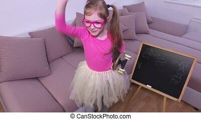 Funny girl using magic wand