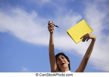 Funny girl with a yellow notebook