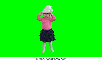 funny girl with curly hair put white santa hat isolated on...