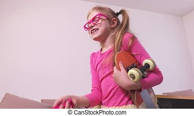 Funny girl with magic wand and skateboard