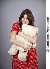 Funny girl with teddy bear