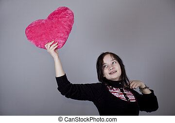 Funny girl with toy heart.