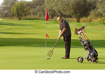 Funny Golfer - Funny Male Golfer Playing Golf With Pitchfork