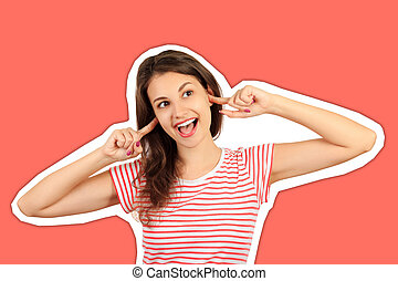 Funny goofy young woman with bug eyes grimacing, having stupid and ridiculous facial expression. emotional girl Magazine collage style with trendy color background