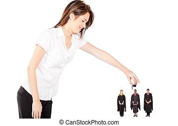 funny graduation - young woman putting cap on graduates