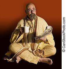 Funny guru sitting lotus style taking a coffee break while reading the newspaper..