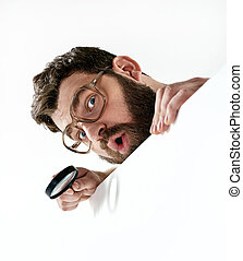 Funny guy holding a magnifying glass