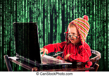 Little child typing on the keyboard. Selective focus on the child