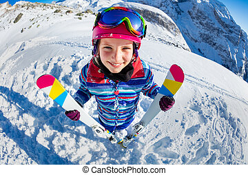Funny happy girl portrait view from above with ski