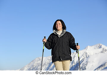 Funny hiker woman trekking in the mountain