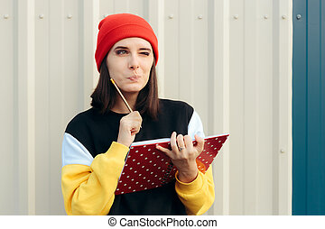 Funny Hipster Woman Writing Something Down in an Agenda - ...