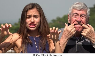 Funny Hispanic Grandfather And Granddaughter