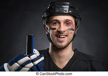 Funny hockey player smiling with one tooth missing. Isolated...