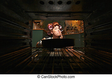 Funny Housewife Smoking and Cooking Dinner in a Vintage Oven...