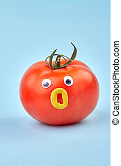 Funny humalike tomato with opened mouth. Isolated on blue ...