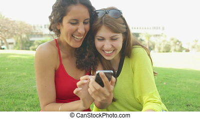 Funny Images - Two girls laughing at something on the screen...