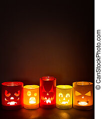 Funny jack-o-lanterns on a dark background