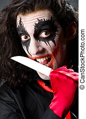 Funny joker with sharp knife
