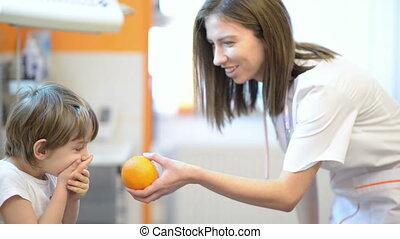 Funny Kid at medical visit - Funny kid refusing an orange at...