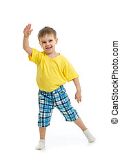 Funny kid boy dancing isolated on white
