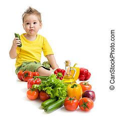 Funny kid boy eating vegetables. Healthy food concept.