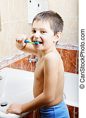 Funny kid brushing teeth