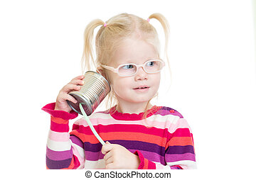 Funny kid in eyeglasses using a can as a telephone isolated