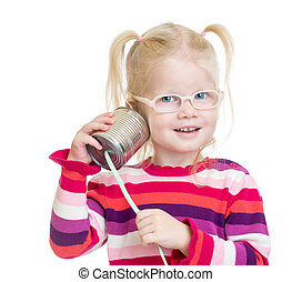 Funny kid in eyeglasses with can as a telephone isolated