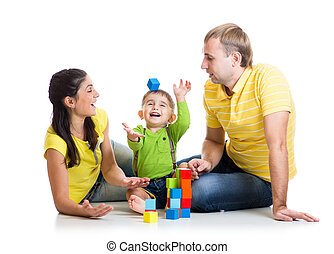 funny kid with parents play building blocks