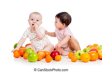 Funny kids babies eating healthy food fruits isolated on white background