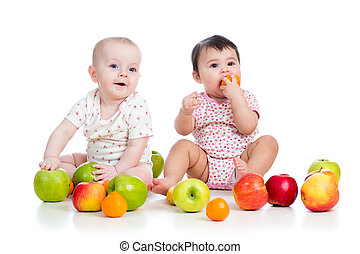 Funny kids babies eating healthy food fruits isolated on white