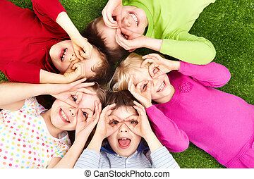 Image of funny kids playing on the grass