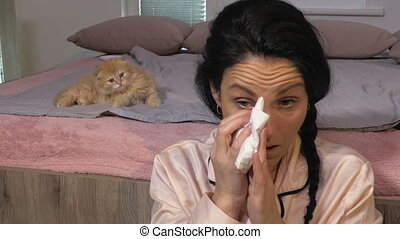 Funny kitten try to help Allergic woman